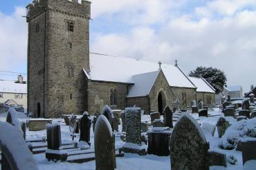 exterior view of St Tyfodwgs's Church in the snow