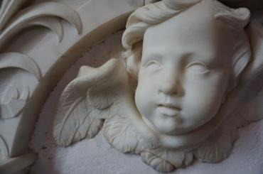 white moulding angel face