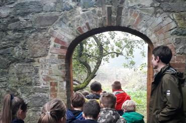 children entering gate of The Bishops Park, The Old Bishops Palace