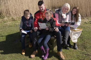 group of people reading leaflets